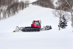 Snow Groomer on a Ski Slope Royalty Free Stock Image
