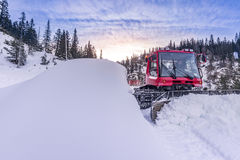 Snow groomer vehicle clearing snow off the road Royalty Free Stock Photo
