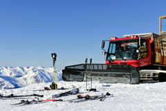 Snow grooming heavy duty machine on top of alpine slopes. Val Thorens, Alps, France, February 12 2015: Snow plough used for snow grooming, standing on top of stock photography