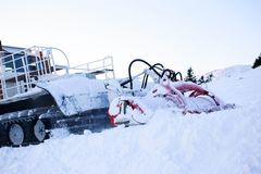 Snow blower machine. Snow grooming machine ratrak on ski slopes in a winter resort royalty free stock photography