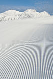 Snow grooming machine tracks. Tracks made by a snow grooming machine on a ski slope in the Alps royalty free stock photos