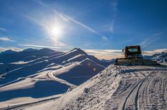 Snow-grooming machine in the winter mountains. Lonely snow-grooming machine in the winter mountains, Toussuire ski resort, Alps, France Stock Photography