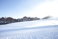 Snow ground in front of village Royalty Free Stock Images