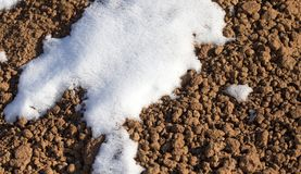 Snow on the ground. In the park in nature Stock Photo