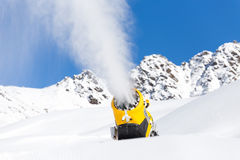 Snow gun in the mountains Royalty Free Stock Photo