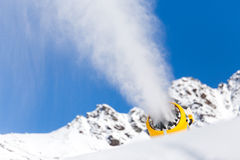 Snow gun in the mountains Stock Photos
