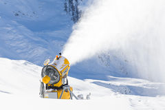 Snow gun in the mountains Stock Photo