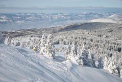 Snow gun. On the ski slope and winter mountain landscape Stock Photos
