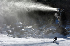 Snow Gun Snowmaker throw snow over a snowboarder in Whakapapa skifield Royalty Free Stock Photos