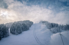 Snow gun. Winter view of the ski slope with snow guns functional Stock Images