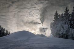 Snow gun. Winter view of the ski slope with snow guns functional Stock Photo