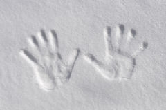 Snow handprints Royalty Free Stock Image