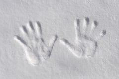 Snow handprints Royalty Free Stock Image