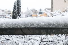 Snow on the handrail of an iron railing. Cold ice and snow in wi stock photography