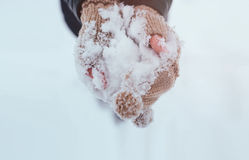Snow in hands wearing gloves Royalty Free Stock Photo