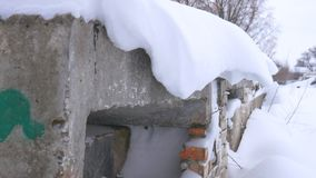 Snow hangs dangerously. Possible descent or collapse of snow. A slew of snow. Caution. stock video footage