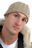 Snow hat. A handsome man in a winter coat and hat Stock Photography