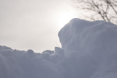 Snow with Hazy Sun Behind It Stock Photos