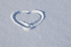 Snow heart. A heart is drawn on to snow Royalty Free Stock Image