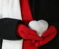 Snow Heart. Woman in Black Coat holding a White Snow Heart Royalty Free Stock Image