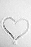 Snow heart. Heart on the fresh snow stock images