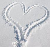 Snow heart. Heart print on pure snow Royalty Free Stock Photo