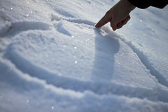 Snow Heart. White snow heart on fild stock images