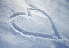 Snow Heart. White snow heart on fild royalty free stock image