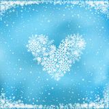 Snow heart on blue background Royalty Free Stock Photography