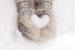 Snow heart in hands. The Snow heart in the hands of girl Stock Photo