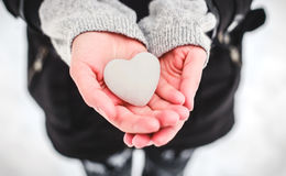 Snow heart in hands. Saint Valentine's day concept Stock Image