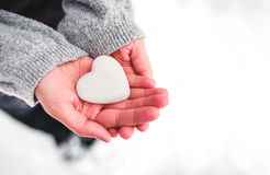 Snow heart in hands. Saint Valentine's day concept Royalty Free Stock Photo
