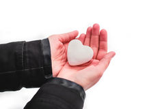 Snow heart in hands. Saint Valentine's day concept Royalty Free Stock Images