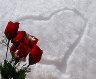 Snow heart with red rose bouquet Stock Photo