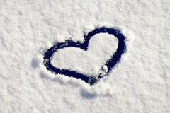 Snow heart symbol on ashpalt Royalty Free Stock Photo
