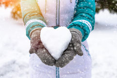 Snow heart in woman's heand. Winter romantic Stock Images