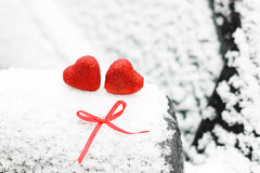 Snow hearts red winter two. Snowy day shape of hearts red color in winter day Stock Images