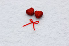 Snow hearts red winter two. Snowy day shape of hearts red color in winter day Stock Photo