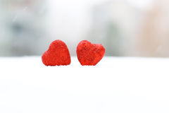 Snow hearts red winter two. Snowy day shape of hearts red color in winter day Stock Image