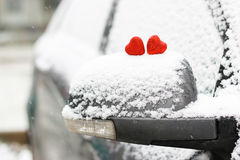 Snow hearts red winter two. Snowy day shape of hearts red color in winter day Royalty Free Stock Photos