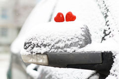 Snow hearts red winter two. Snowy day shape of hearts red color in winter day Stock Photos