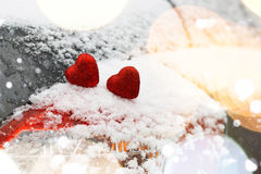 Snow hearts red winter two. Snowy day shape of hearts red color in winter day Royalty Free Stock Photo