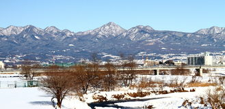 Snow covered ground. A heavy fall of snow covered the ground and the Mountains Royalty Free Stock Photos