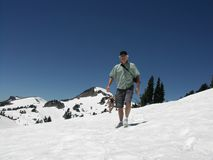 Snow Hiking. Man hiking in snow in the summer Stock Photos