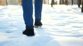 Snow walking foot man. Snow hiking walking foot steps feet stock video