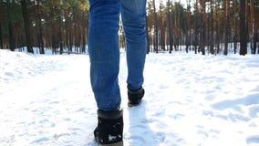 Snow walking foot man. Snow hiking walking foot steps feet stock footage