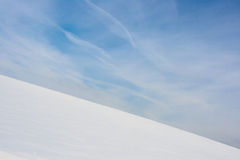 Snow hill. Snowy hill on and a blue sky Royalty Free Stock Photography