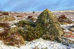 Snow on a  hill. Rocks on a snow covered hill Stock Photography