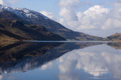 Snow on the Hill in Lake reflection Stock Image