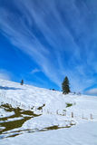 Snow hill meadow and blue sky Royalty Free Stock Photo